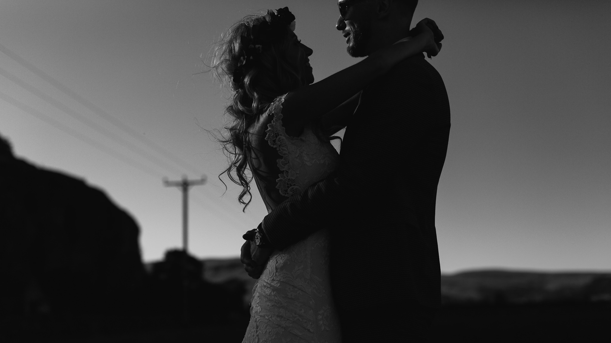 A black and white sunset portrait
